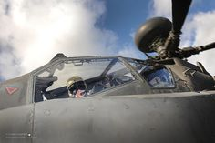 Army Air Corps Apache Helicopter Pilot Prepares for Take Off by Defence Images