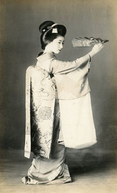 Dragon and Pearl Obi, ca. 1910. Maiko (Apprentice Geisha) Momotaro, dancing with a mai-ogi (dancing fan), her obi (sash) decorated with dragons and pearls. S)
