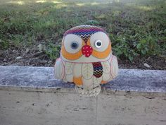 I have made several owls to date. They all have a rattle inside and are weighted by their   talons.  This is Charlie, made her for a friends daughter.
