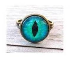 A blue cat eye ring. kind of cool and creepy at the same time! I Love Jewelry, Jewelry Rings, Jewelery, Jewelry Accessories, Jewelry Box, Unique Jewelry, Cats Eye Ring, Cat Eye, Chesire Cat