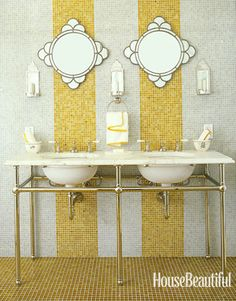 "In a Sonoma country house, designer Jay Jeffers boldly used ""an abundance of glass tiles"" from Waterworks covering the entire floor and the wall behind a pair of Waterworks sinks. Deco mirrors from Pottery Barn. #stripes"