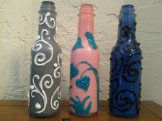 More bottle art.  Also painted the inside of these with acrylic, and the outside with puff T-shirt paint for texture.