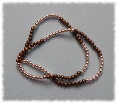 Delikatna bransoletka podwójnie wiązana na gumce silikonowej      długość bransoletki bez rozciągania - 16,5cm