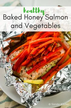 This simple Baked Honey Salmon and Vegetables is cooked in foil and ready in under 20 minutes. It's a healthy and easy meal that can be made with your favorite veggies and spice blends. Salmon Recipes, Fish Recipes, Seafood Recipes, Ww Recipes, Seafood Dishes, Veggie Recipes, Healthy Eating Recipes, Healthy Baking