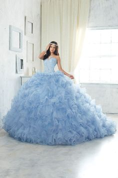 Look stunning in a House of Wu Quinceanera Dress Style Number 26847 during your Sweet 15 party or any formal event. Made from ruffled organza and sparkle tulle cascading down from the waist in waves a