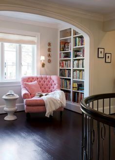 Love this book nook! The chair looks so comfy... just needs something to put your feet up on...  |Traditional Hall by Barnes Vanze Architects, Inc
