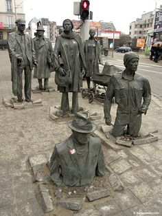 The Anonymous Pedestrians Sculpture, Wroclaw, Poland by Jerzy Kalina. Fourteen statues representing Martial Law in 1981 Poland, when many people went underground or disappeared in the middle of the night, taken by the militia. Photo by bartoszewicz.