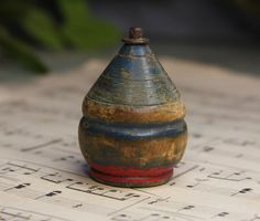 old painted wooden spinning top