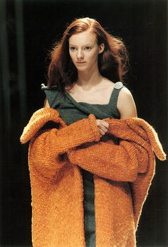 cotonblanc:   Radical KnitwearYohji Yamamoto, autumn/winter 1998–1999. In contrast to McQueen, the simplicity of hand-knitting and the basic construction of Yamamoto's pieces conjured a romantic innocence and naïveté, as the models hugged the comforting knitting around themselves. The shapes of the coat and dress are simple rectangles, the edges left to curl. The accompanying advertising campaign showed the clothes in strange, magical settings in the forest in full moonlight.  Knitwear in…