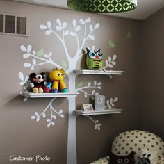 """This is a tree decal that is created to work with standard 24"""" wall shelves that you can find at your local Target, Walmart, etc.. (shelving NOT INCLUDED) There are three locations where you can fit the shelves. This tree looks great on its own as well! Tree Size (approx): 55""""w x 94""""h 51""""w x 88""""h version is available upon request. The price is the same. Please leave a note in the """"message to seller"""" box during checkout if you would like the 88""""h vers..."""