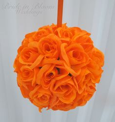 Orange pomander kissing ball flower girl by BrideinBloomWeddings