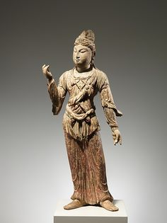 The figure's posture suggests that this sculpture represents a bodhisattva who served as an attendant to a Buddha or some other transcendent figure. It was most likely part of a larger group of figures depicting various members of the Buddhist pantheon