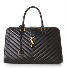 """**SOLD** NWT Saint Laurent Medium Matelasse Cabas SAINT LAURENT  Medium Matelasse Cabas Monogram Handbag with Chevron-quilted leather exterior, dual rolled handles, metal feet at base, zip top and snap-tab with interlocking YSL logo closures. Optional leather encased keyring, gold-tone hardware, suede interior lining, center zip divider and open compartments, interior zip pocket. Accompanied by dust bag and authenticity card. 14"""" L x 9 1/2"""" H x 7"""" W Made in Italy Yves Saint Laurent Bags…"""