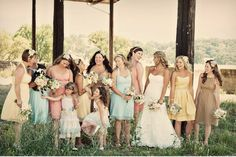 Different pastel colored dresses with bride in chiffon dress...??? An idea that's cute too