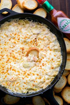This 1-pan hot shrimp artichoke dip is the perfect holiday appetizer. This shrimp dip is easy, creamy, cheesy, fully loaded, and boy is it ever good!