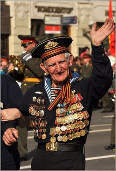 World War II Russian veteran wearing a Navy uniform with numerous orders and medals