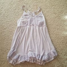 Racer back tank top Very cute slightly worn tracer back tank top. In great condition still no holes rips stains. Has cute lace details and flowers great tank for summer. Decree Tops Tank Tops