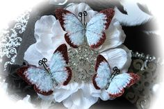 Ruby Slippers Glitter Glass Butterflies~add a touch of glittery elegance  to your Holiday projects with these red & white beauties~so perfect in Christmas Trees, Garlands, Home Decor, on packages or for any of your paper crafting projects~  https://www.etsy.com/listing/166620587/ruby-slippers-glitter-glass-butterflies?ref=shop_home_active