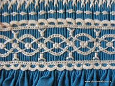 "Beautiful ""lace"" smocking."