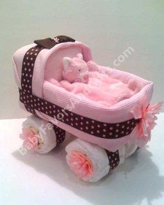 Diaper baby carriage; website has cute baby shower gift ideas