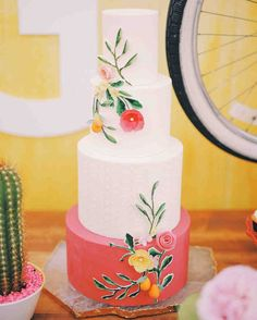 the colours on this wedding cake are so vibrant and beautiful