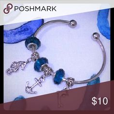 Blue charm bracelet. Free earrings. Beautiful blue charm bracelet with a dolphin, anchor and seahorse charm. You will love it and you can add your own charms. Free earrings included with your purchase! Fast shipping! Jewelry Bracelets