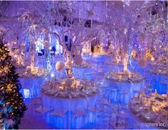the lights under the table skirts! and the tree branches for centerpieces!!!