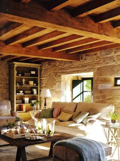 exposed beams, exposed stone walls.
