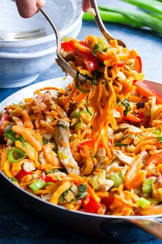This paleo and Whole30 spin on veggie and pork lo mein uses sweet potato noodles for a delicious real-food meal that's gluten-free, grain free, soy free.