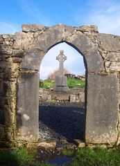 Panoramio - Photo of Ruins of The Seven Churches (Celtic Cross through Doorway)