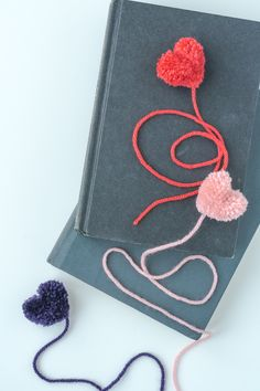 These DIY heart pom pom bookmarks are easy to make. You only need yarn and scissors! They would be sweet for classmate valentines and so inexpensive.