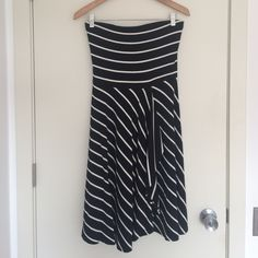AT strapless black and white striped dress Jersey dress. Faux-wrapped skirt. Knee length. Flattering waistline. Ann Taylor Dresses