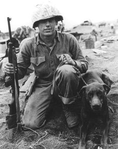 US Marine Private Francis Hall and his Doberman war dog Iwo Jima Japan March 1945.