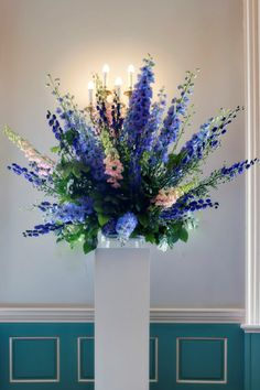 Imagine this type of look as no container flowers will be in a bowl that sits on the stand.