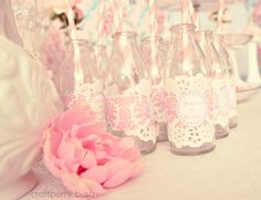 Cute way to decorate drink bottles for the party, attach a white paper lace doily under printed bottle wrapper or printed duct tape.