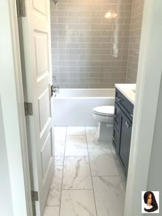 Bathroom Remodel The tile flooring that looks like marble in this bathroom creates a stunning loo. The tile flooring that looks like marble in this bathroom creates a stunning look. It is light and gives this space a refreshing feel. Marble Bathroom Floor, Hall Bathroom, Upstairs Bathrooms, Bathroom Renos, Dyi Bathroom, Neutral Bathroom, Bathroom Hardware, Simple Bathroom, Small Bathroom Ideas