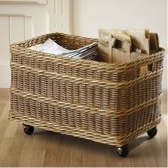 Looking for a practical but lovely storage solution for recyclable paper? This simple wicker basket becomes a traveling recycling bin with the addition of four furniture casters. Fill it up and roll it out!