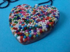 rainbow nonpareil resin heart necklace by WittyJosefiend on Etsy, $6.50