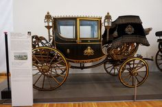 Lavish personal 2-seater town carriage of Empress Elisabeth. The Imperial Carriage Museum (Wagenburg), in Vienna, Austria.