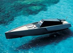 I love this power yacht. The name escapes me right now, but the manufacturer also builds sail yachts and runabouts, as well as some smaller power yachts and powerboats.