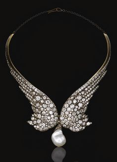DIAMOND NECKLACE, 1860S.  Designed as a pair of wings, set with circular- and rose-cut diamonds, suspending at the front a later baroque cultured pearl drop,  fitted case by Gianmaria Buccellati.