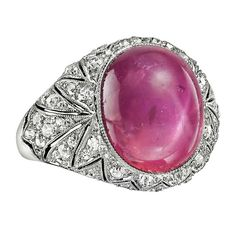 Cartier Art Deco Star Ruby Diamond Platinum Ring. Star ruby and diamond ring, centering on a natural oval-shaped cabochon star ruby weighing approximately 8.50 carats, with circular-cut diamond accented shoulders, in a fancy platinum mount, circa 1925, numbered 2318813, signed Cartier. c 1925