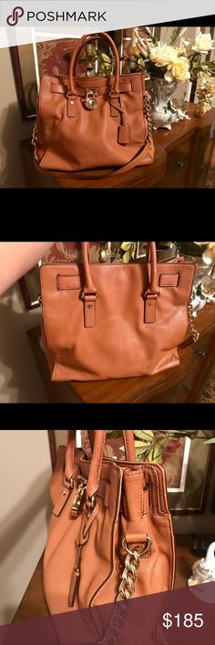 """Michael Kors Hamilton Bag Adorable Michael Kors Handbag/Shoulder Bag. Light Brown. In Excellent Condition Like New! Barely Used. Model No. AP-1309. Magnetic closure. Gold tone Hardware. Logo lock and key charm. One inside zip pocket, 4 other pockets. Great bag to use for office, travel and for daily use. Size Length 13"""" x Height 13"""" x Width 4.5"""". Michael Kors Bags Satchels"""