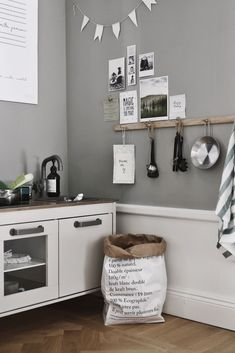 bylund // LOVE this kids play corner with kitchen and rack for hangin