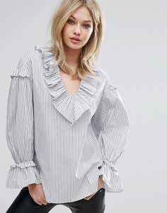 Get this Mango's printed blouse now! Click for more details. Worldwide shipping. Mango Stripe Frill Detail Balloon Sleeve Top - Multi: Top by Mango, Lightweight woven fabric, Striped design, V-neck, Dropped shoulders, Flared cuffs, Frill trims, Oversized fit - falls generously over the body, Machine wash, 84% Cotton, 12% Polyamide, 4% Elastane, Our model wears a UK S/EU S/US S and is 175cm/5'9 tall. ABOUT MANGO Combining timeless style with fashion forward designs, Barcelona-born Mango are…
