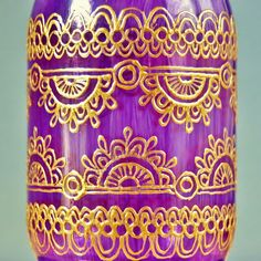 Can make this jar from hobby lobby and gold puffy paint.or white puffy paint dried then painted gold/gold paint marker Violet Glass Mason Jar Lantern with Gold Henna Style Accents on Wanelo.I shall attempt to make! Mason Jar Lanterns, Mason Jar Vases, Painted Mason Jars, Bottles And Jars, Mason Jar Crafts, Mason Jar Diy, Glass Jars, Candle Jars, Gold Henna