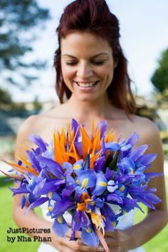 Bridal bouquet with blue iris and bird of paradise.