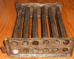 ANTIQUE TIN CANDLE MOLD FOR 12 TAPER CANDLES