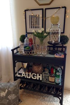 Bar cart styling the 2 Ladies way! We love the way these HomeGoods gold polka dot glasses and drink dispenser sparkle on the bar cart and make entertaining easy! Sponsored by HomeGoods.