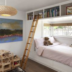 great use of space for a small kids bedroom. built in bed with storage over and under window (artistic designs for living)